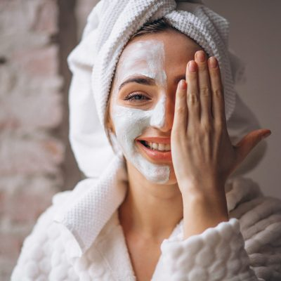 Portrait of a woman with a facial mask half face